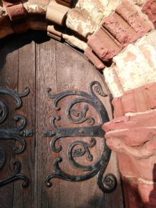 Beautiful red and yellow sandstone and old hinges, St Magnus Cathedral, Kirkwall, Orkney. Pilgrimage on St Magnus Way